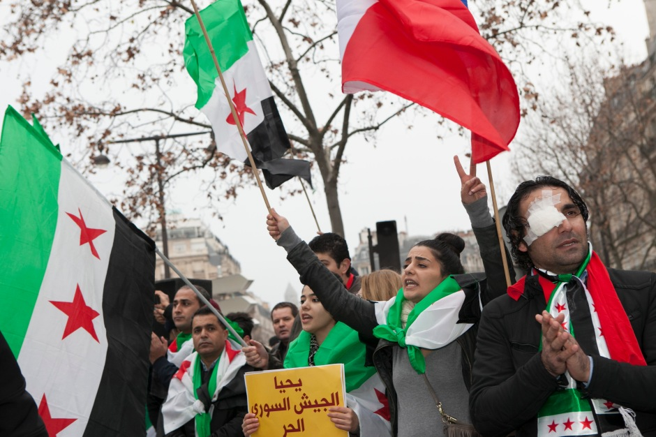 Paris, France, Syrians and Iranians protest across the Iranian Embassy in Paris